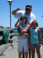 "Click to enlarge image Sharing his love of fishing with his granddaughters Gillian and Alexis! - Gonzalo ""George"" O'Higgins - 1943 - 2010"